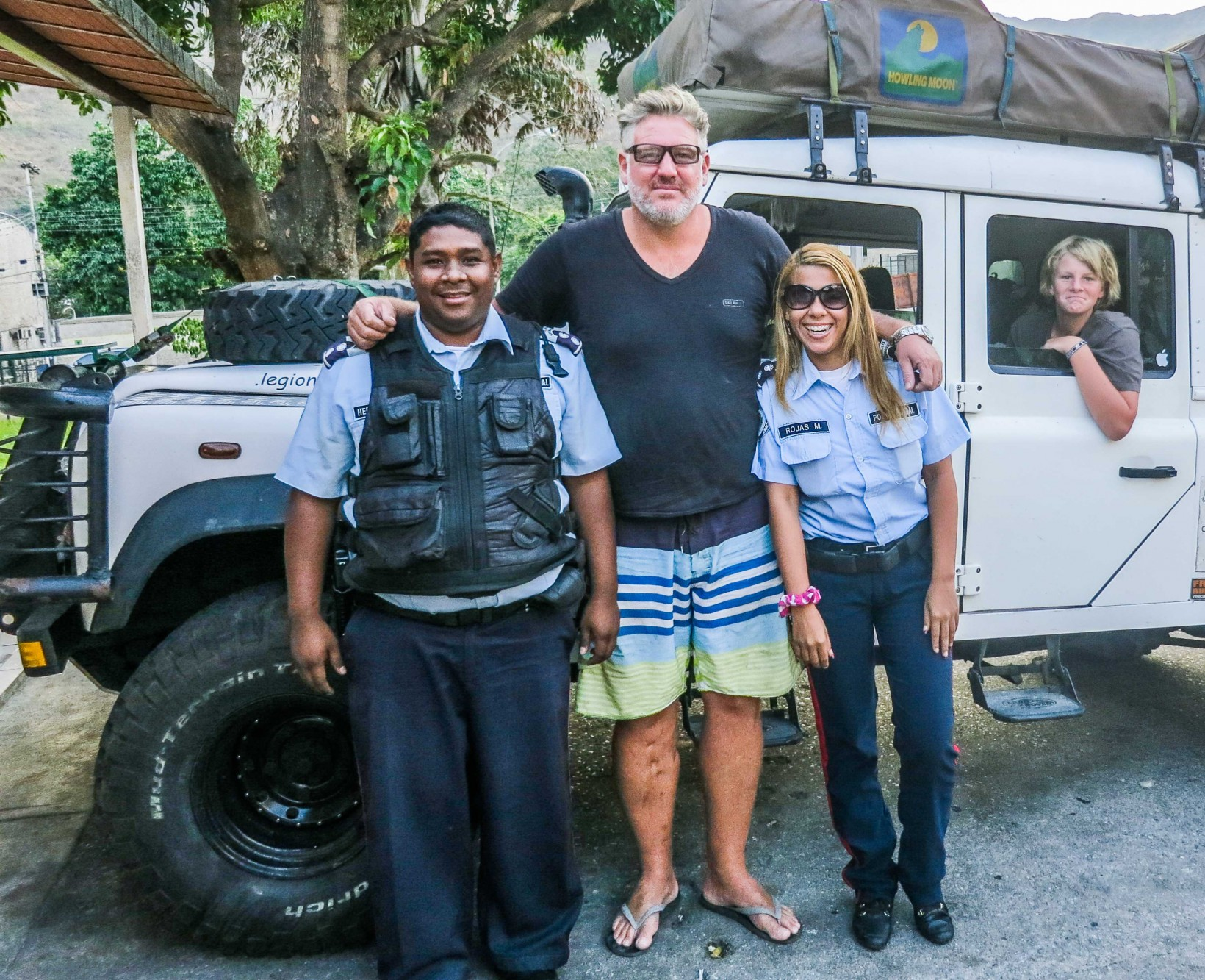 The police who had followed and harrased us for money pose for a photo. We never gave them a cent.