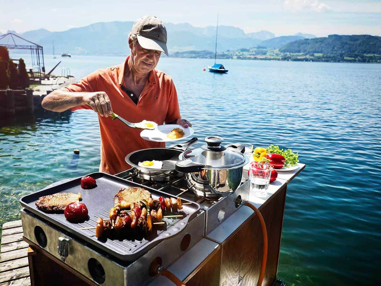 LARGE guy cooking by sea