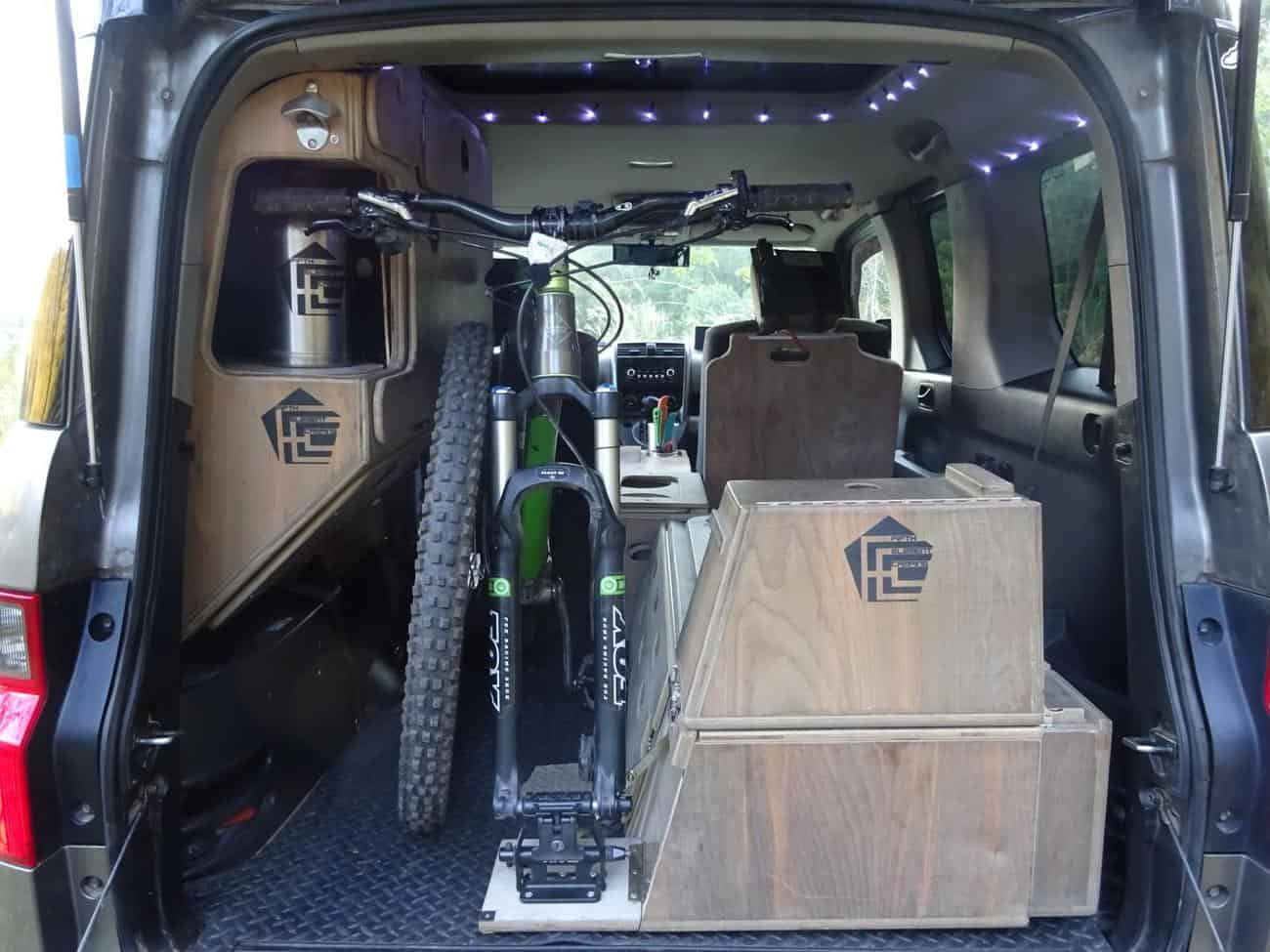 Quick and secure bike loading. The cabinet allows loading of bike handlebars. FifthElementCamping.com (Copy)