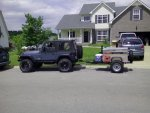 trailer and Jeep in front of house.jpg