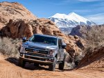 Ford F250 Tremor with Norweld Deluxe Weekender Tray on Sandy Road Below La Sal Mountains.jpg