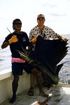 Greg with Sailfish in CR.jpg