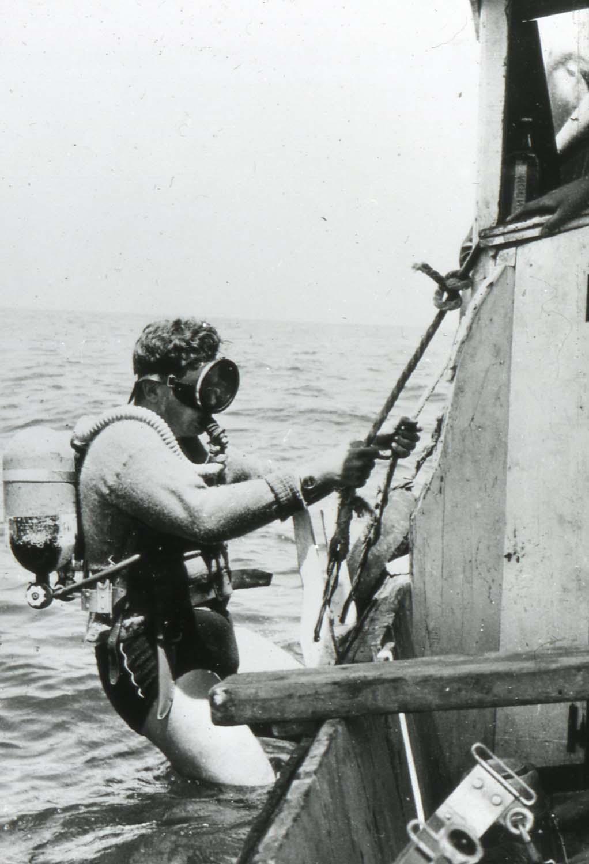 Diving in woolie jumpers_ 1958