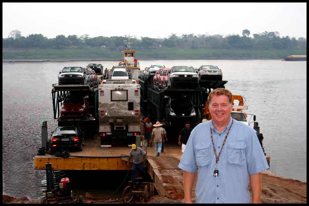 global expedition vehicle on a barge in south america